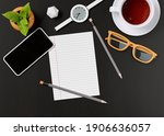 office desk with a cup of tea ... | Shutterstock . vector #1906636057