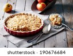 Apple crumble on the wooden background with apples