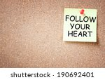 Small photo of sticky note with the phrase follow your heart over cork board. room for text