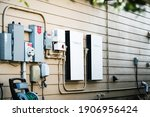Small photo of Austin , Texas , USA - January 26th 2020: Tesla Powerwall Home battery storage connecting home energy storage with solar panels and powering the grid with a self sustaining future