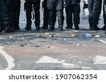 Small photo of Belfast, UK, 12 July 2012 - Stones and bricks litter the road as police riot squad move forward to force a crowd of youths to retreat.