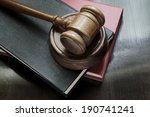 judge's gavel and legal books