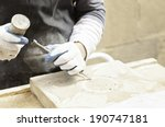Man Carving Stone Detail Of A...