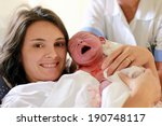 happy mother holding her baby ... | Shutterstock . vector #190748117