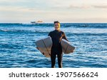 Young Surfer Comes Out Of The...