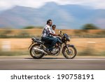 Small photo of KERALA, INDIA - FEBRUARY 17: Man with child riding on a bike (blurred motion). Motorbike is the most favorite vehicle and most affordable for India.