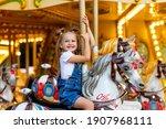 Happy girl in an amusement park ...