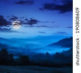 cold night fog in moon light in the mountains - stock photo