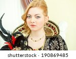 Small photo of Portrait of young red-haired royal personage