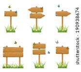 Set Of Wooden Signs In A Grass...