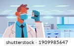 male doctor in mask holding... | Shutterstock .eps vector #1909985647