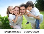 portrait of happy family of four   Shutterstock . vector #190999025