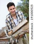 smiling man in home garden... | Shutterstock . vector #191000525