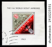 Small photo of Ankara, Turkey - 5 February 2021: A Nigerian 2 triangle stamps souvenir sheet shows the 11th world scout jamboree. Circa 1963. Canceled by seal...