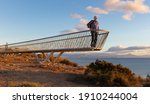 A Backpacker Hiker Stands At A...