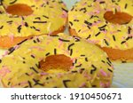 yellow donuts lie next to each... | Shutterstock . vector #1910450671
