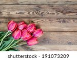 Red Tulip Flower On Wooden Table