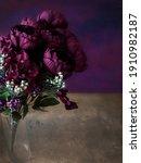 Purple Flowers In A Glass Vase...