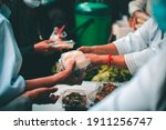 Volunteers Donating Food To...