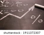 Small photo of chalk, calculations of figure and curve, the concept of growth as hypothesis according to which all essential information is immediately and fully reflected in the market market value of securities