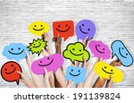 hands holding smiley faces... | Shutterstock . vector #191139824