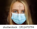 Girl With Cross Made From Ash...