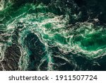 Small photo of Waves of water of the river and the sea meet each other during high tide and low tide. Whirlpools of the maelstrom of Saltstraumen, Nordland, Norway