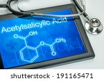 Small photo of Tablet with the chemical formula of acetylsalicylic acid