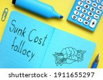 Sunk cost fallacy is shown on the conceptual photo using the text