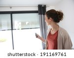 woman using remote control to... | Shutterstock . vector #191169761