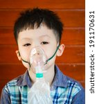 asian boy wearing oxygen mask. | Shutterstock . vector #191170631