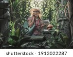 Small photo of Naive tourist having a phone call in the jungle, she is lost and scared
