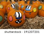 Small Pumpkins Are Painted Wit...