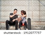 young asian adult man and woman ... | Shutterstock . vector #1912077757