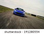 Blue Sport Car On Race Way....