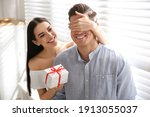 Lovely Couple With Gift Box At...