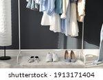 rack with stylish women's... | Shutterstock . vector #1913171404