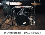 A Black Drum Kit With Cymbals...