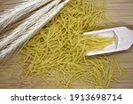 Dry Wheat Pasta On A Wooden...