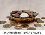 Pot with coins from different countries arround world. Brazil, Mexico, Chile, Argentina, Uruguay and others