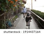 Tourists Are Cycling Along The...
