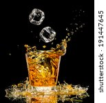 glass of whiskey with splash on ... | Shutterstock . vector #191447645