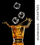 glass of whiskey with splash on ... | Shutterstock . vector #191447651