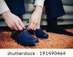 Groom Putting His Wedding Shoes....