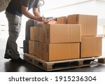 Warehouse Worker Holding...