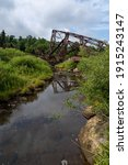 A Creek With The Wreckage Of...
