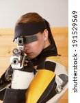 Small photo of Woman training sport shooting with air rifle gun