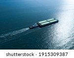 Tugboat Pulling Barge With...