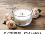 Beautiful Roses Near Candle In...