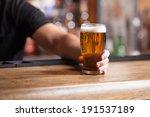 Freshly Tapped Beer. Bartender...